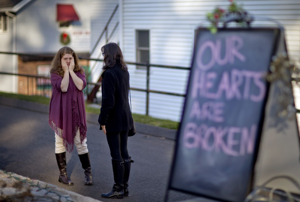 Shop owners Tamara Doherty, left, and Jackie Gaudet, right, meet