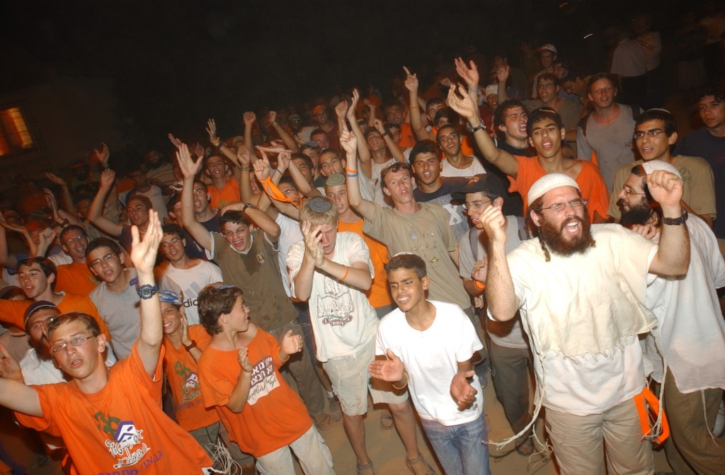 "Israelis protest the Gaza withdrawal, July 2005. ""The years have passed,"" wrote Stern, ""but the stones hurled at me that day at the Kotel and the venom I felt sizzling behind my back still disturb my peace."" (Flash 90)"