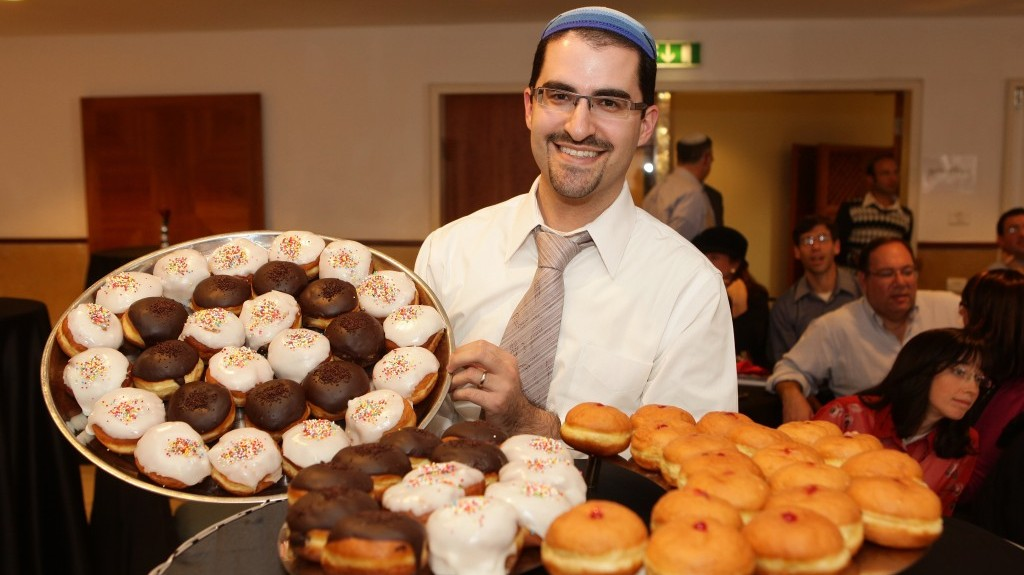 In the name of non-profits, Elie Klein has been eating dozens of donuts since before the start of Hanukkah. (photo credit: Courtesy of Yissachar Ruas)