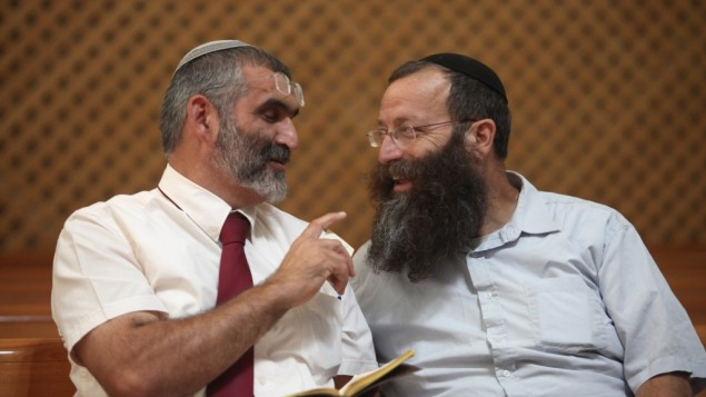 Baruch Marzel speaks with MK Michael Ben-Ari, Sep 6 2012. (photo credit: Yoav Ari Dudkevitch/Flash90)