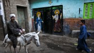 A man rides on a donkey in the village of El-Aziyah near the southern Egyptian city of Assiut on Tuesday.(photo credit: AP/Petr David Josek)