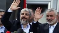 Exiled Hamas chief Khaled Mashaal, left, and Gaza&#039;s Hamas Prime Minister Ismail Haniyeh wave during a news conference upon Mashaal&#039;s arrival in the Gaza Strip on December 7. (photo credit: AP/Suhaib Salem, Pool)