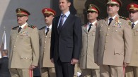 Syrian President Bashar Assad, center, stands next to Syrian Defense Minister Gen. Dawoud Rajha, right, and Chief of Staff Gen. Fahed al-Jasem el-Freij, left, during a ceremony to mark the 38th anniversary of the October 1973 Arab-Israeli war, in Damascus, Syria, last year (photo credit: AP Photo/SANA)