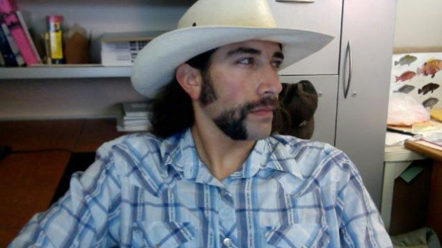 The author and his mo, which raised $1,000 to help raise awareness and find a cure for testicular and prostate cancer.