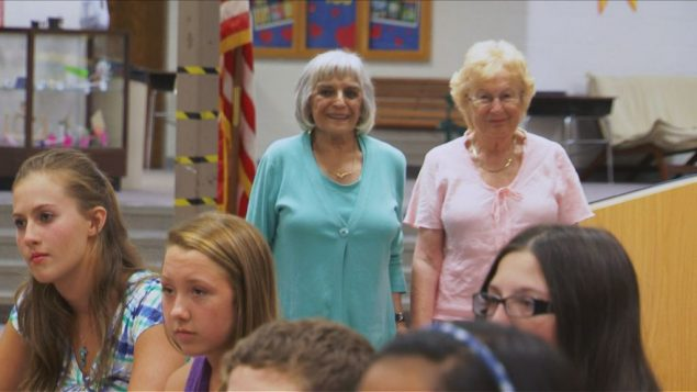 Holocaust survivors Edith Schumer and Gerda Frumkin surprise the Naperville students who helped to reunite them. OWN Network