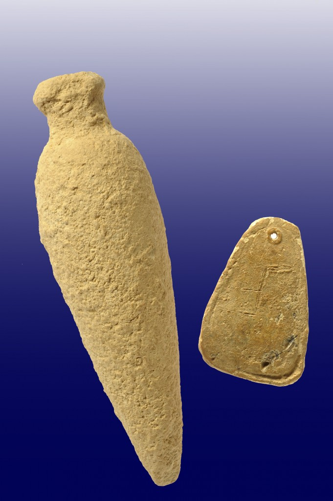 A perfume bottle and a lead weight bearing a carved letter were found at the Kiryat Hayovel dig (Courtesy of the Israel Antiquities Authority)