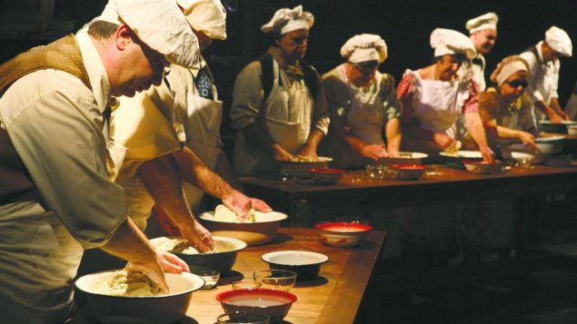 "Nalag'at actors knead dough in ""Not by Bread Alone."" Courtesy of Nagal'at Theater"