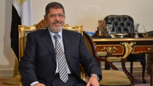 Mohammed Morsi poses prior to a meeting with Iranian Foreign Minister in Cairo on Jan. 10. Getty Images