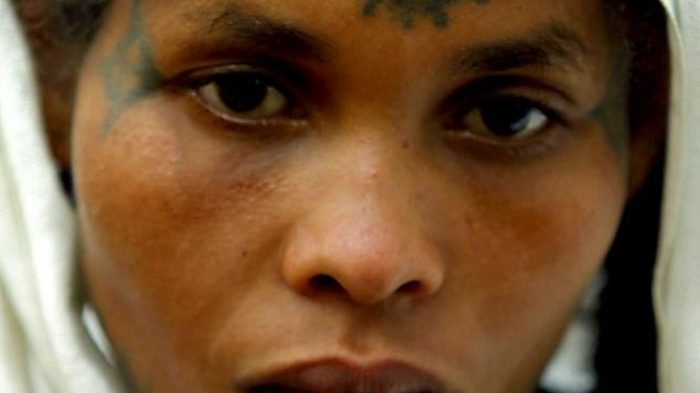 A Jewish Ethiopian woman with a cross tattooed on her forehead poses for a portrait in Addis Ababa. Getty Images