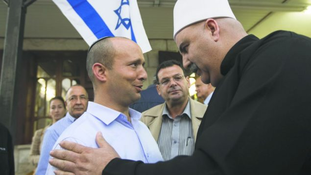 Naftali Bennett, left, head of the Jewish Home party, meets with a member of Israel's Druze community. getty images