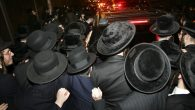 The Satmar sect, of which Necheyma Weberman is a member, mourn the death of their rabbi in 2006. Getty Images