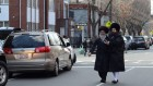 Two Hasidic men walk in Williamsburg, one of two Brooklyn neighborhoods that account for most of the Jewish population growth in the New York area. (Gedalya Gottdenger via Creative Commons and JTA)