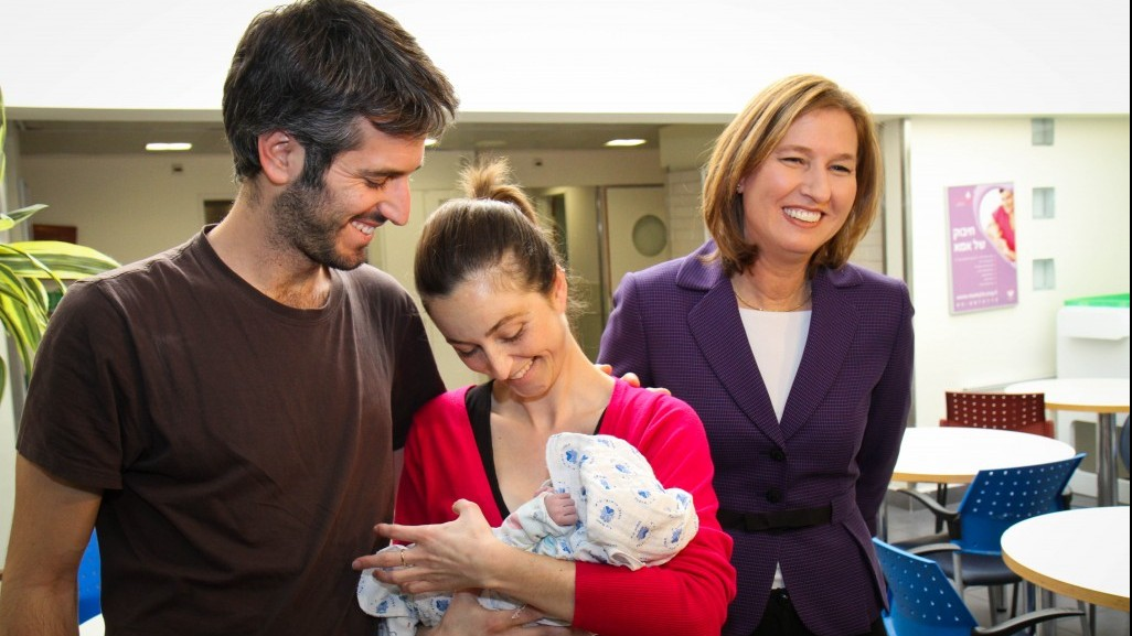 Tzipi Livni, left, visits Merav Cohen and her husband, and the couple's newborn baby girl, in Tel Aviv Tuesday. (photo credit: Publicity)