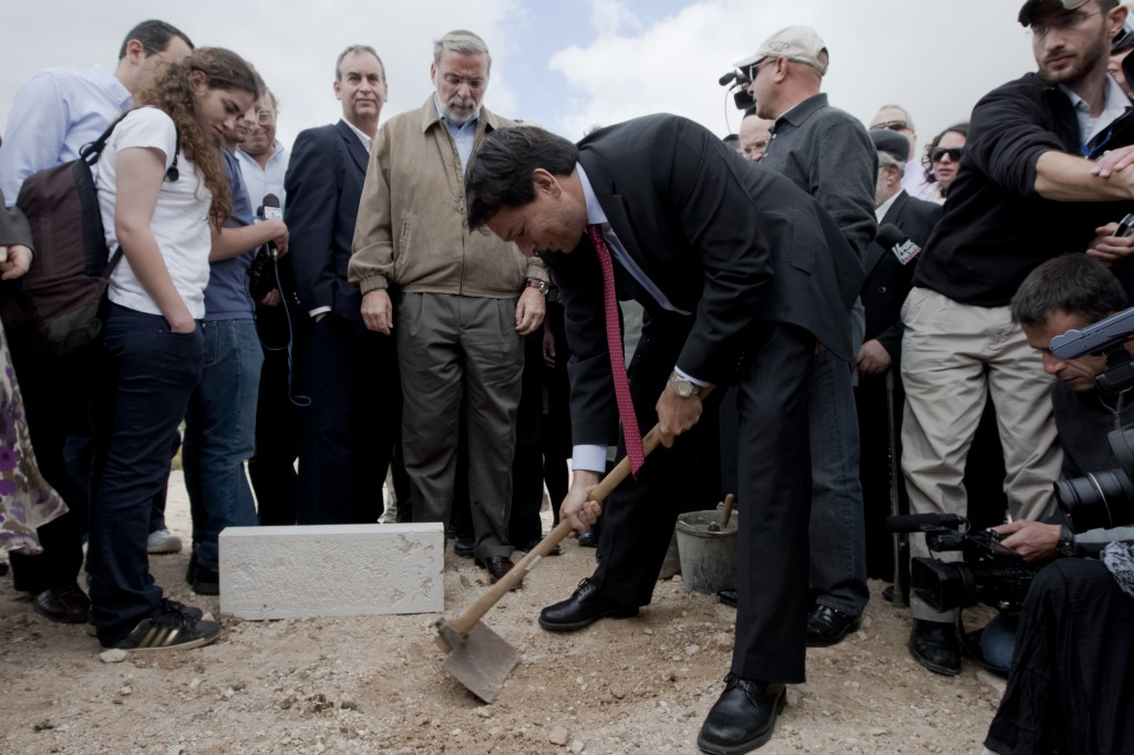 "Danon lays a symbolic cornerstone for new Jewish construction in east Jerusalem, November, 2009. Settlements, Danon says, ""are not an obstacle to peace"" (Flash90)"