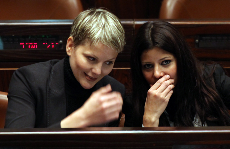 Yisrael Beytenu Knesset members Anastasia Michaeli and Orly Levy-Abekasis share a giggle during a Knesset session, February 2010 (photo credit: Yossi Zamir/Flash 90)