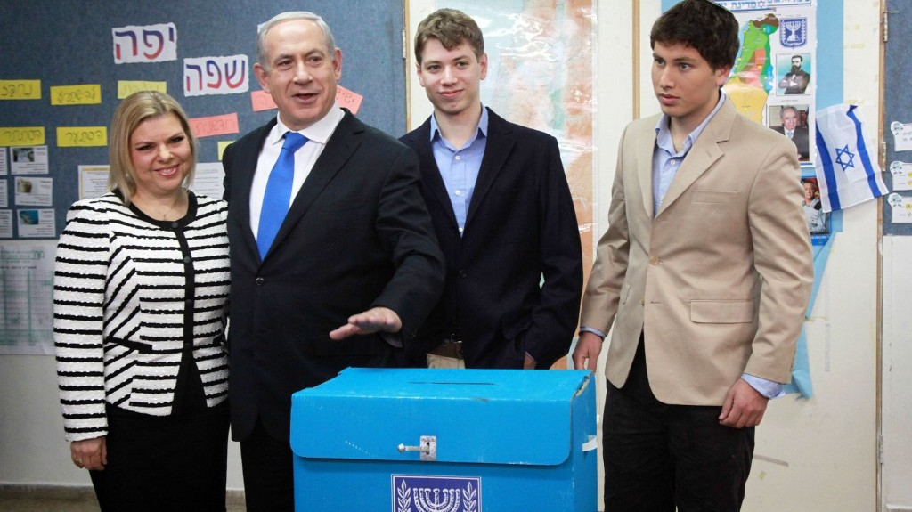Prime Minister Benjamin Netanyahu, his wife Sara and their sons Avner and Yair cast their votes at a polling station in Jerusalem on January 22, 2013. (Photo credit: Marc Israel Sellem/POOL/FLASH90)