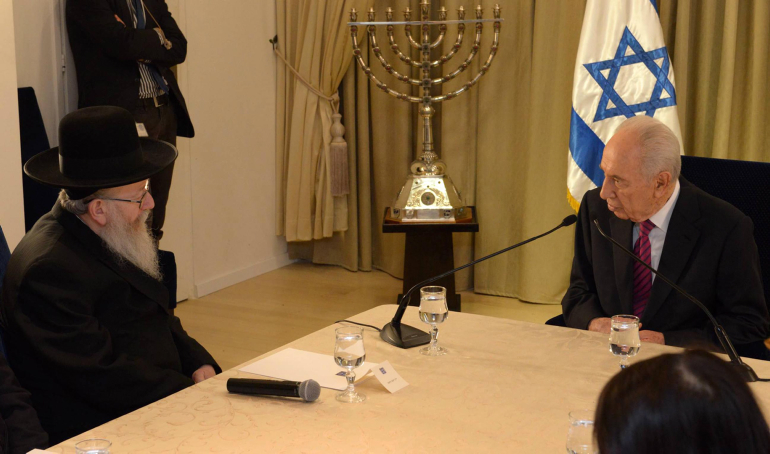 President Shimon Peres meets with United Torah Judaism's Yaakov Litzman, in Jerusalem, January 31 (photo credit: Mark Nayman/GPO/Flash90)