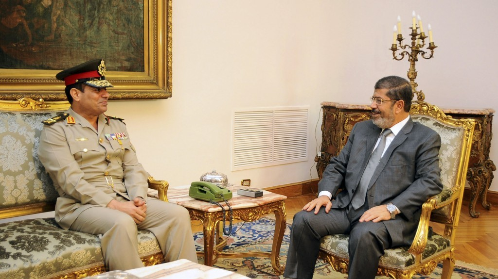 Egyptian Defense Minister Lt. Gen. Abdel-Fattah el-Sissi, left, meets with Egyptian President Mohammed Morsi in Cairo, Egypt, last August (photo credit: AP/Egyptian Presidency/File)