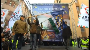 Jobbik party supporters burning an EU flag at a rally in Budapest in 2012. (photo credit: screen capture/YouTube video uploaded by Euronews)