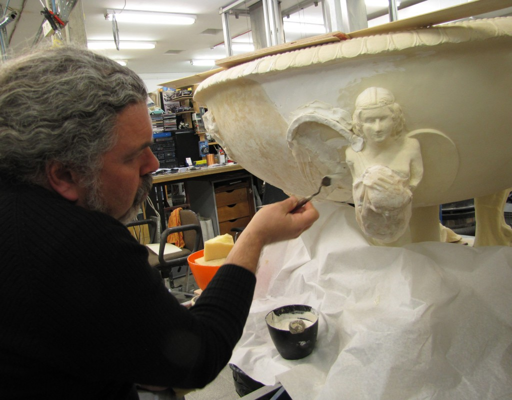 Victor Uziel, a restorer at the Israel Museum laboratories, working on a footed marble basin decorated with a winged female figure. The basin was probably given to Herod as a gift from Emperor Augustus or his second in command, Marcus Agrippa (photo credit: Andrei Vainer)
