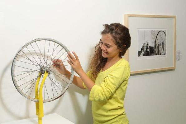 Checking out the bikes at the kids' exhibit in the main hall of the Tel Aviv Museum of Art (Courtesy Tel Aviv Museum of Art)