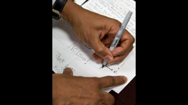 President Obama signs letters from children after unveiling new gun control proposals on Jan. 16. (White House Photo)