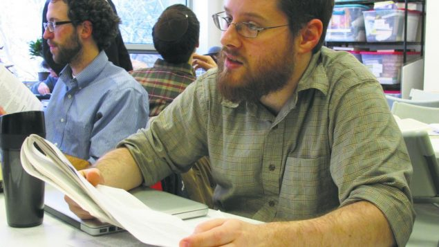 Rabbinical student Raif Melhado and a study partner make their way through a text on Jewish law and the deaf. Helen Chernikoff