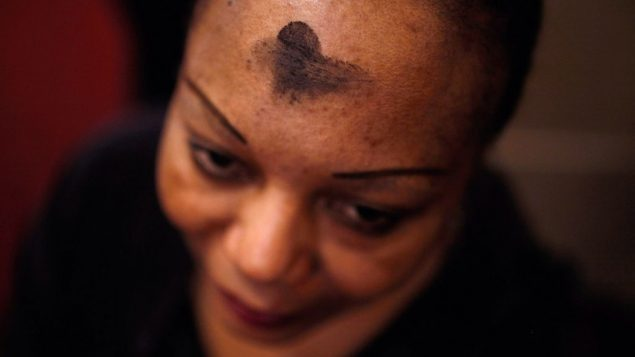 A Catholic woman prays with an ash cross on her forehead in Washington, D.C. in 2012. Getty Images