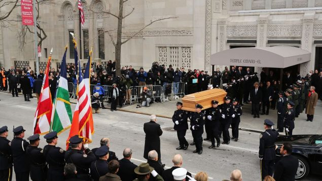 Members of the New York Police Department carry Ed Koch's casket after services at Temple Emanu-El. Getty Images