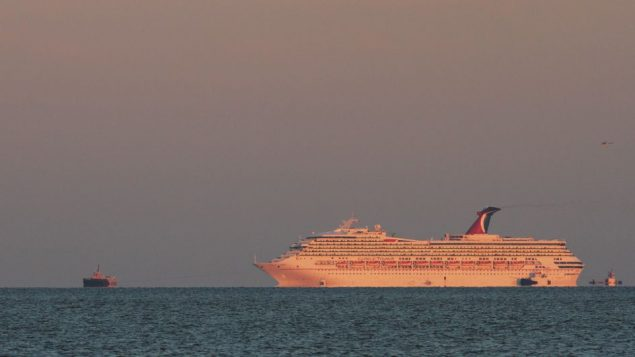 The Carnival Triumph makes its way, with assistance, up Mobile Bay. Getty Images