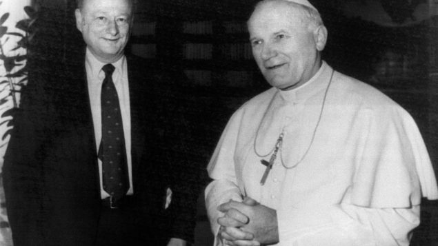 One icon, and another: Koch and Pope John Paul II. Getty Images