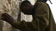 An IDF soldier of Ethiopian descent prays at the Western Wall in Jerusalem (photo credit: Matanya Tausig/ Flash90)