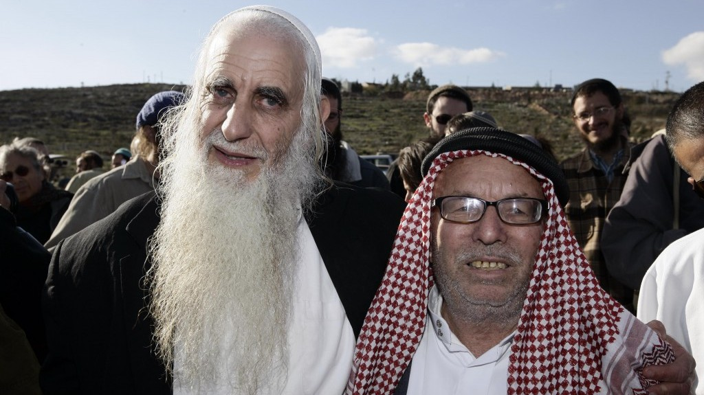 Froman (left), at a roadblock outside the West Bank village of Yasuf, near Nablus, in 2009 (Photo credit: Abir Sultan/Flash90)