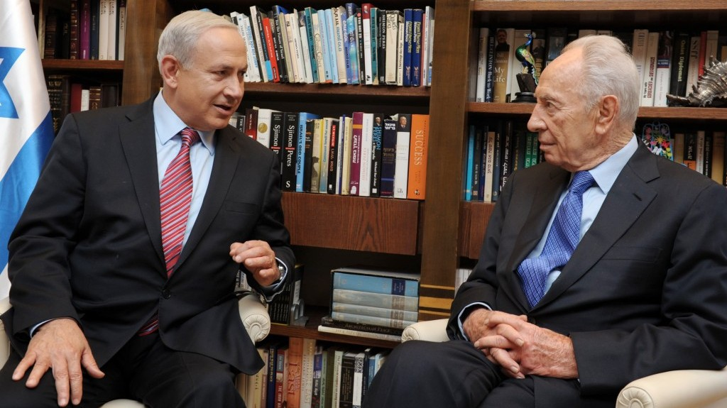 Prime Minister Benjamin Netanyahu with President Shimon Peres on October 10, 2012, formally submitting his resignation ahead of elections. (photo credit: Moshe Milner/GPO/FLASH90)