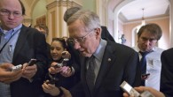 Senate Majority Leader Harry Reid of Nev. makes his way to the Senate floor on Capitol Hill in Washington, Thursday, February 14, after a Democratic caucus meeting. (photo credit: AP/J. Scott Applewhite)