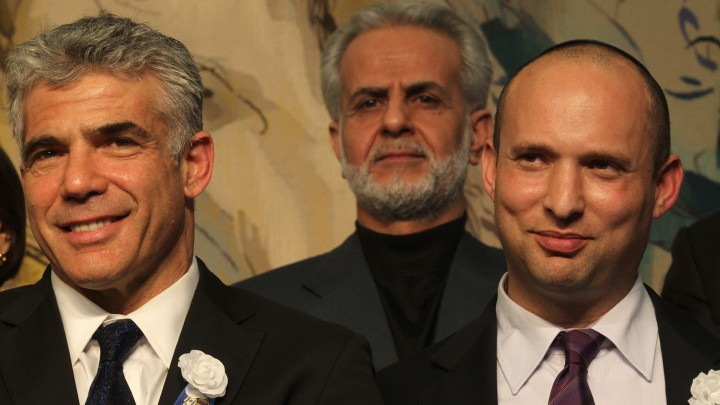 Leader of the Yesh Atid party Yair Lapid seen with Jewish Home leader Naftali Bennett, February, 2013. (photo credit: Nati Shohat/FLASH90)