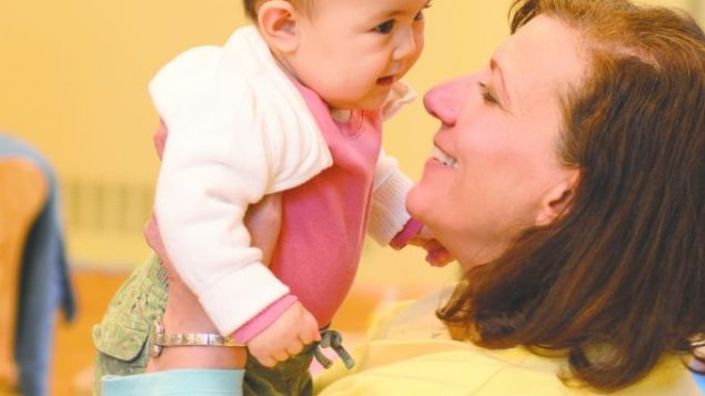 Kehillah's director, Nancy Bossov, with one of the program's infants. courtesy of Temple Israel of New Rochelle.
