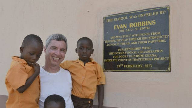 Evan Robbins poses with some of the Ghanaian students at the school he had built in exchange for slaves' freedom.