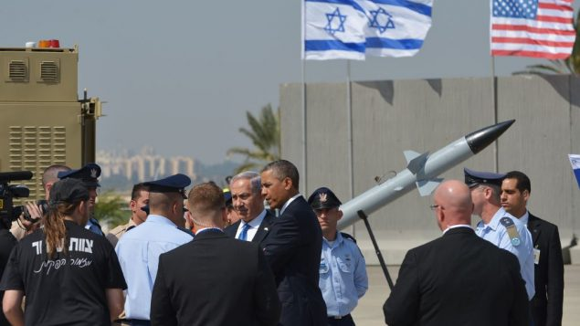 President Obama surveys an Iron Dome battery used against rockets like those fired at Israel Thursday. Getty Images