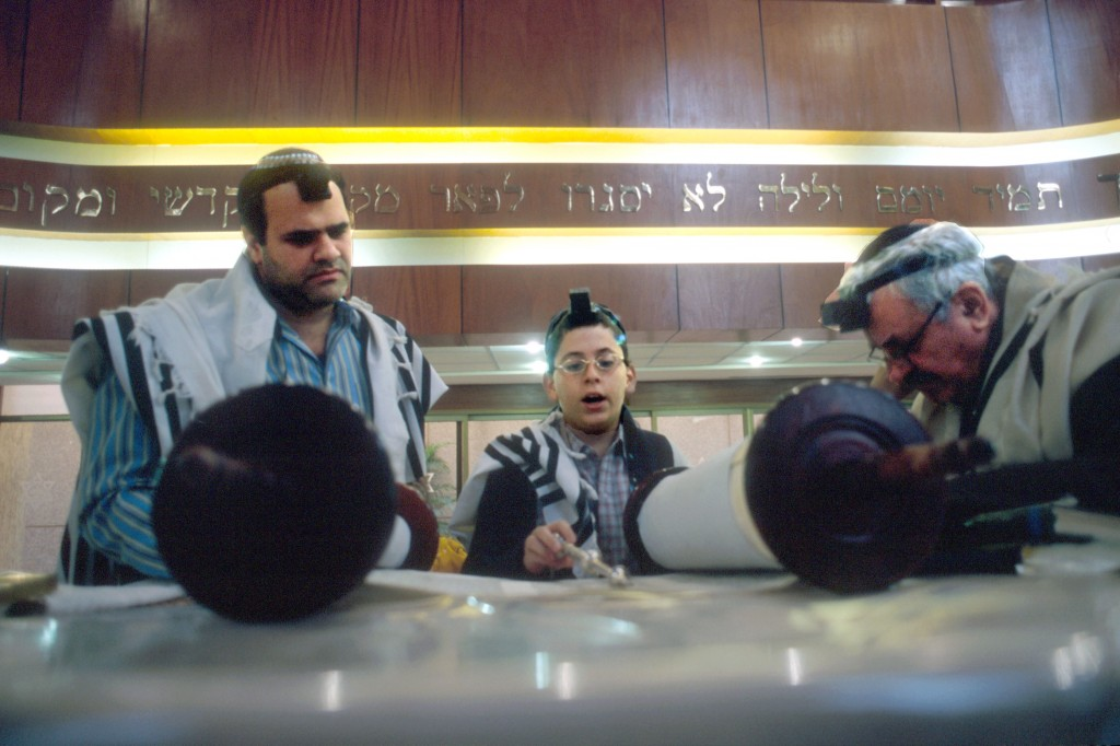 A young Jewish boy reads from the Torah during his Bar Mitzvah in Magen David synagogue in Caracas, Venezuela, in 2005. (photo credit: Serge Attal/Flash90)