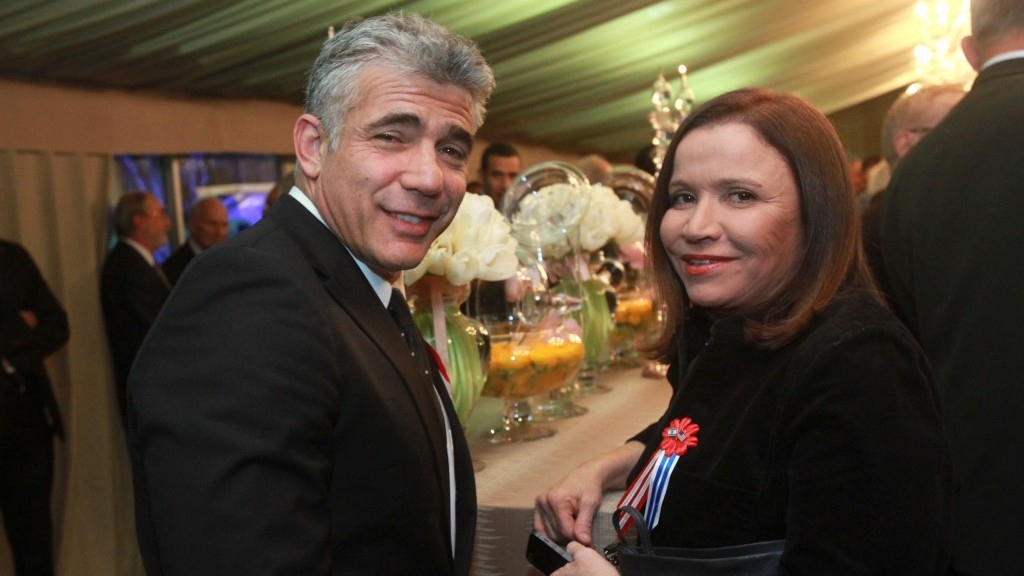 Labor party head Shelly Yachimovich poses with Finance Minister Yair Lapid at a reception in honor of US President Barack Obama at the presidential residence in Jerusalem, Thursday. (photo credit: Yossi Zamir/Flash90)