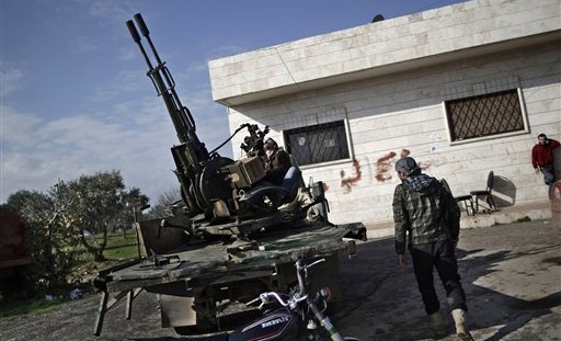 A Syrian rebel checks an anti-aircraft weapon in Maaret Misreen, near Idlib, Syria, on Friday, Dec. 14, 2012 (photo credit: AP/Muhammed Muheisen/File)