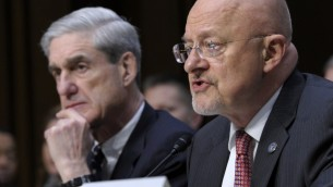 Director of National Intelligence James Clapper, right, accompanied by FBI Director Robert Mueller, testifying on Capitol Hill in Washington, Tuesday. (photo credit: AP/Susan Walsh)