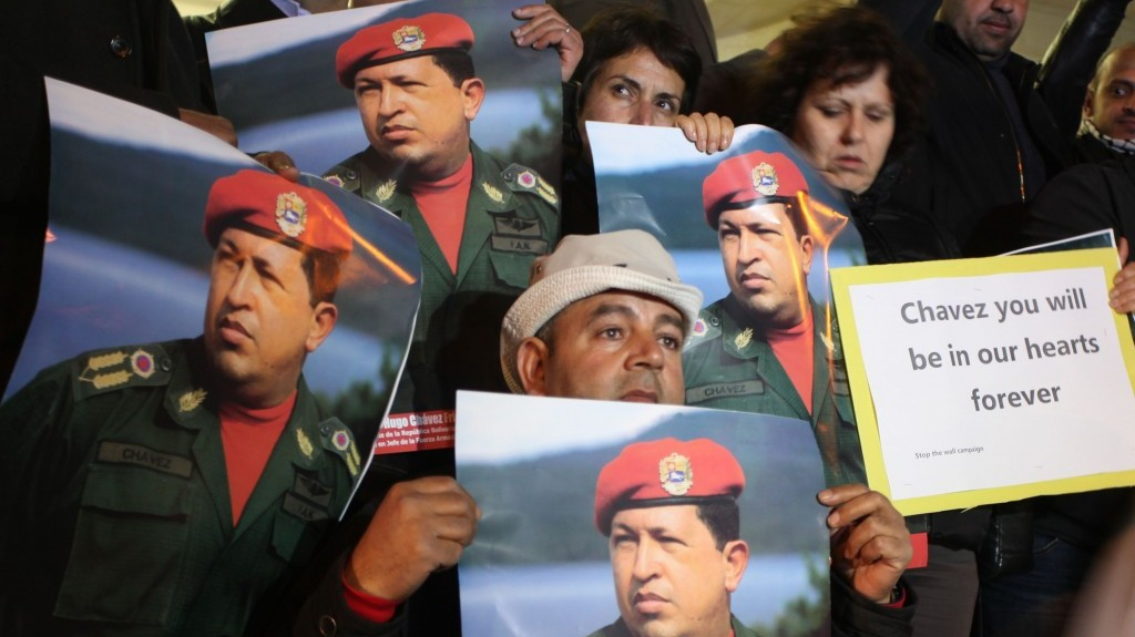 Palestinians hold portraits of late Venezuelan president Hugo Chavez during a rally in front of Venezuelan Embassy, in the West Bank city of Ramallah on March 6, 2013 (photo credit: Issam Rimawi/Flash90)