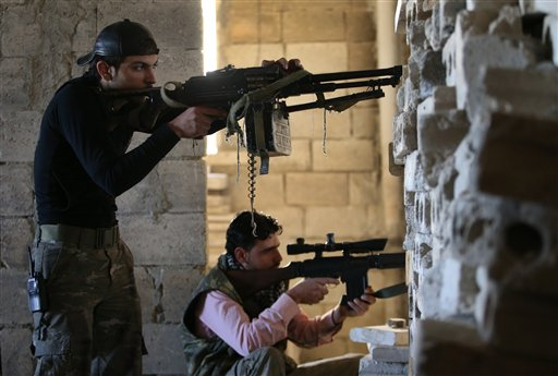 Free Syrian Army fighters at the front line of Maarat al-Nuaman town, Syria, Tuesday February 26, 2013. (phot