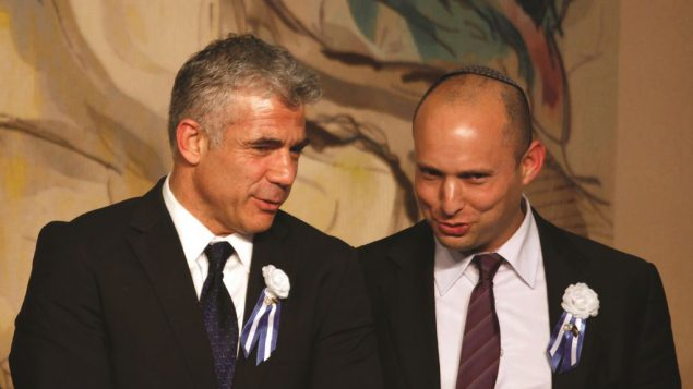 Yesh Atid's Yair Lapid and Jewish Home's Naftali Bennett say they won't join a government with haredi parties. Getty Images