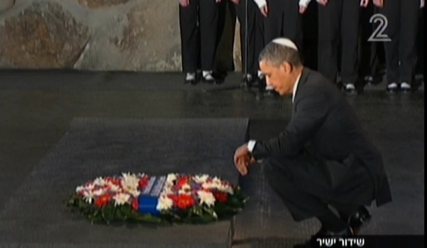 President Barack Obama pauses in contemplation after laying a wreath in memory of the six million Jews who perished in the Holocaust, at Yad Vashem on Friday (photo credit: Channel 2 screenshot)