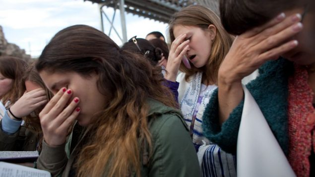 The fervently religious who are obstructing women's prayer at the Wall are desecrating God's name, the author says. Getty Images
