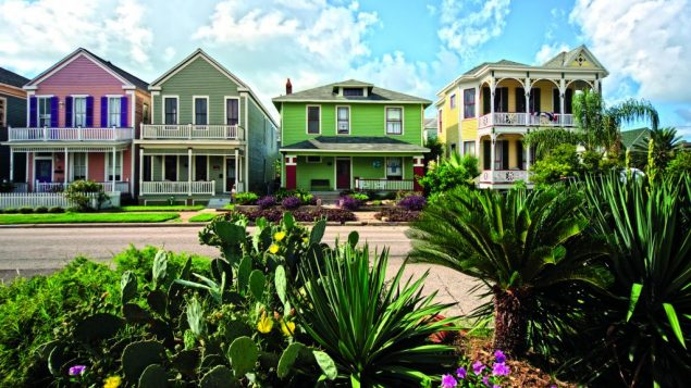 A row of candy-colored homes dot Galveston's historic East End. Photo courtesy Galveston Island Convention & Visitors Bureau