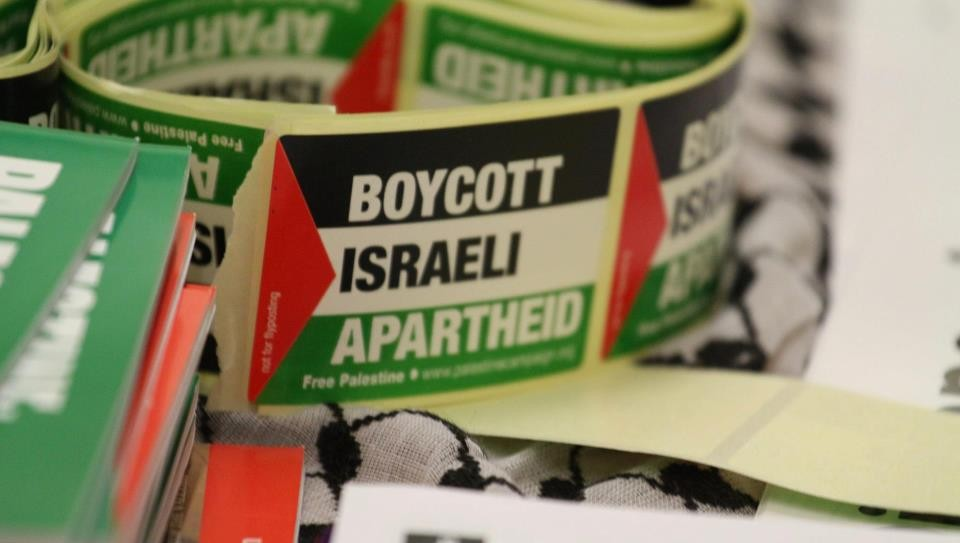 Boycott Israeli apartheid stickers (Tapash Abu Shaim/Palestine Solidarity Campaign UK via Facebook)